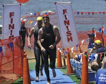 Swimmers complete the grueling challenge, finishing near Hemingway's on Kent Island.