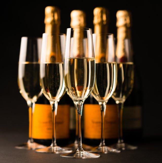 Champagne Glasses and Bottles on Black