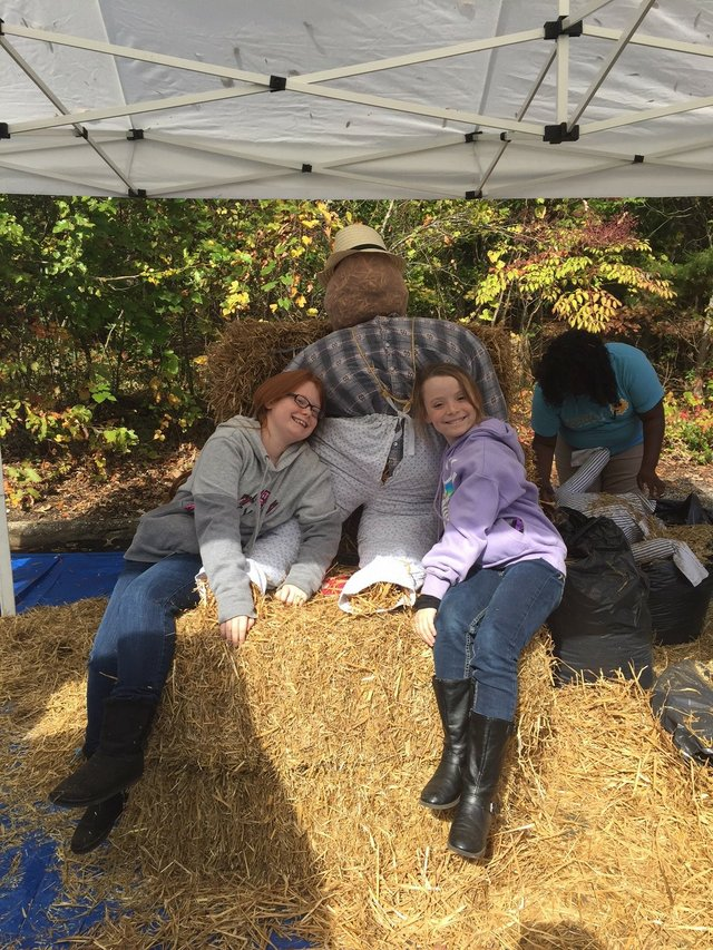 girls posed with a scarecrow.jpg