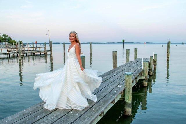 lacey twirl on dock.jpeg