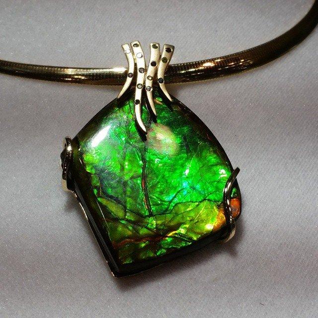 ammolite pendant with diamonds.jpg