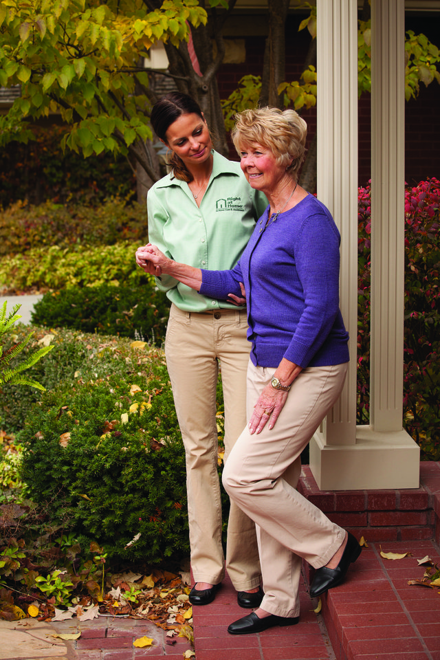 Caregiver walking down steps with client.jpg